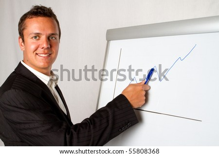 A business man presenting a growth chart