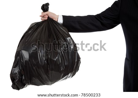 A business man's or bankers arm holding a black bag of trash - bad debt theme, bad investments, bad business - stock photo