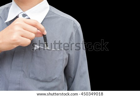 a business man show front and back of right hand pick/holding the black pen from pocket of dark gray shirt. isolated on black background. - stock photo