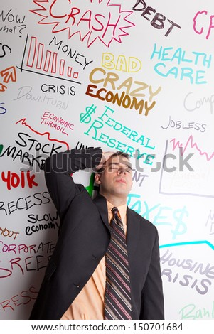 A business man that looks worried about money and the troublesome economic times we are living in. - stock photo