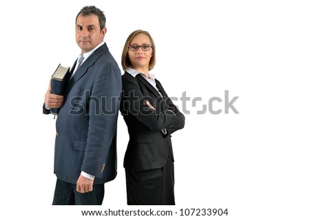 A business man with a book and businesswoman standing back to back with smiles on their faces. Isolated on white