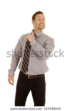 A business man with a funny expression on his face holding on to his tie loosing the tie. - stock photo