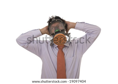 A business man with a gas mask on his face