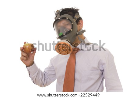 A business man with a mask holding a genetic manipulated apple - stock photo