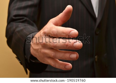 A business man with an open hand