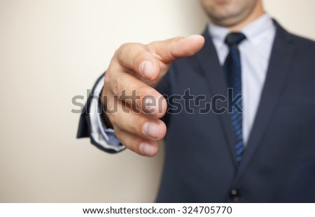 A business man with an open hand ready to greeting - stock photo