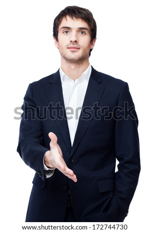 A business man with an open hand ready to seal a deal, isolated on white - stock photo