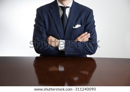 A business man with his arms crossed