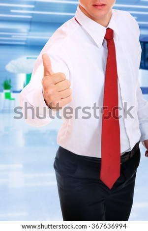 A business man with thumb up over white background - stock photo