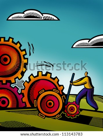 A business man working on inter connected gears
