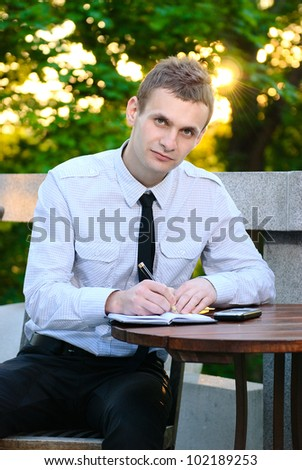a business man works from his office at an outdoor at the cafe