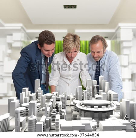 A business team inspecting an architecture project