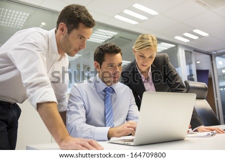 A business team of three in office and planning work - stock photo
