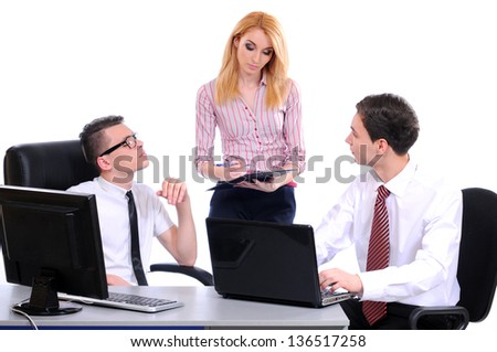 A business team of three plan work in office - stock photo