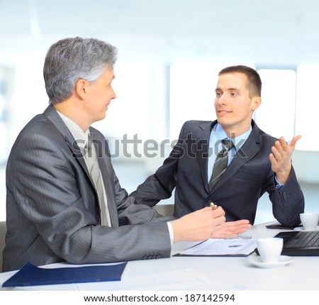 A business team sitting in office and planning work - stock photo