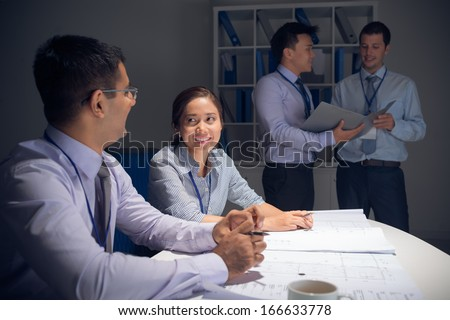 A business team working together on project  - stock photo