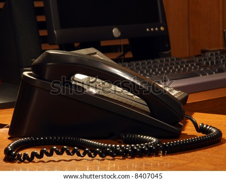 A business telephone in a pool of light at night - stock photo