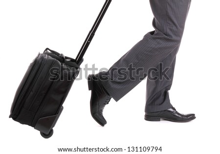 A business traveler with suitcase on white background - stock photo