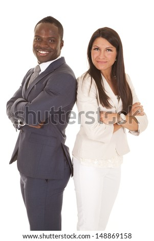 A business woman and man standing back to back with smiles on their faces - stock photo