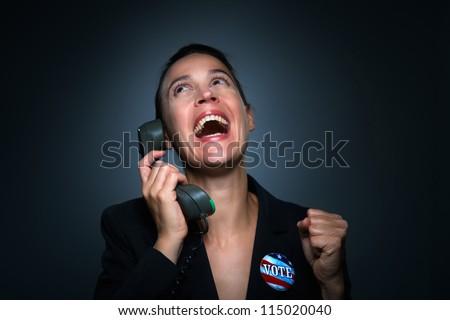 A business woman charcterizing having won an election. - stock photo
