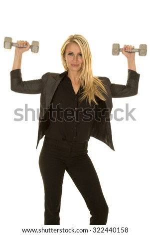 A business woman in her clothes, working out with weights.