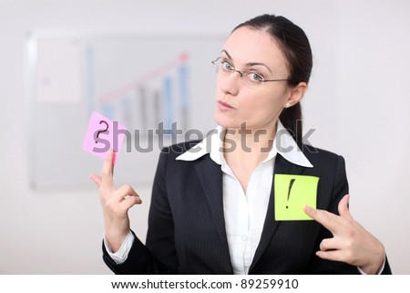 A business woman is holding post its in a conference room. - stock photo