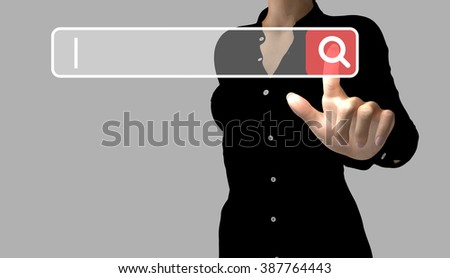 A business woman makes an online search by touching a search button. The cursor indicates the text to enter.