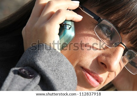 A business woman talking on the cell phone.