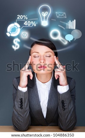 A business woman thinking about her work and tasks and plans. Icons of different actions are flying around her head - stock photo