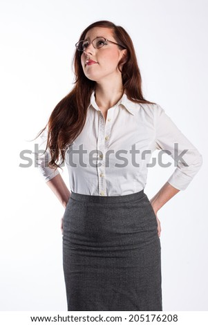 A business woman with glasses looks up.