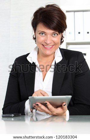 A business woman working on a tablet