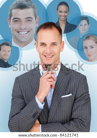 A businessman and some pictures of his colleagues - stock photo
