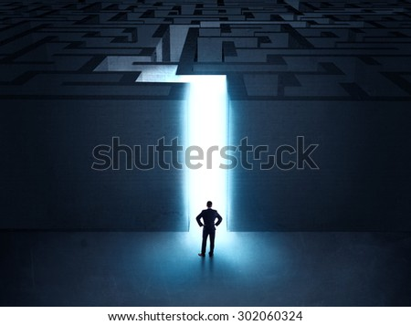 A businessman at the entrance to a maze - stock photo