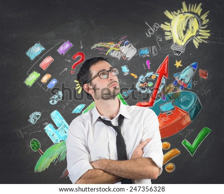 A businessman creates a system to succeed - stock photo