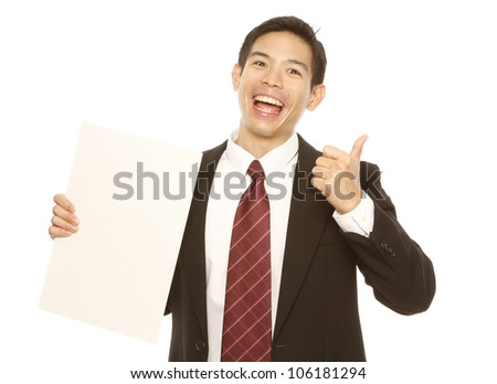 A businessman doing a thumbs up and holding a blank sheet (isolated on white)