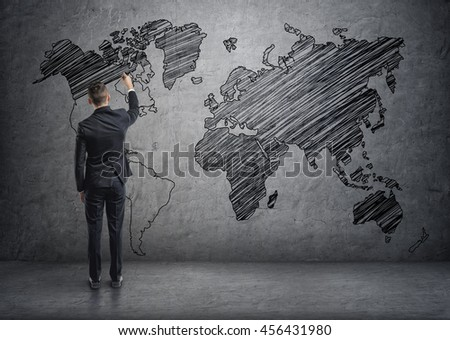 Businessman drawing world map on concrete stock photo 456431980 a businessman drawing world map on the concrete wall unlimited possibilities the world is gumiabroncs Choice Image