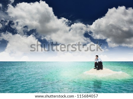 A businessman get stuck on island. A concept of businessman facing a dead end, frustration and hopeless situation in business. Can also be use to illustrate unemployment or financial crisis concept.