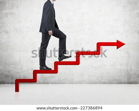 A businessman going up following the line graph. The concept of business development.