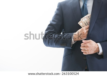 A businessman grabbing money