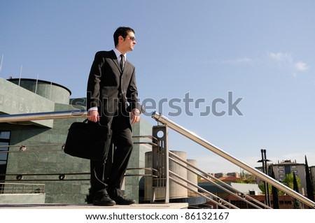 A businessman holding a briefcase - stock photo