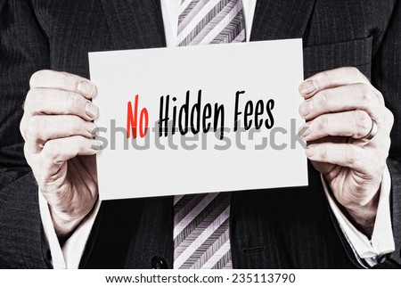 A businessman holding a business card with the words, No Hidden Fees, written on it. - stock photo