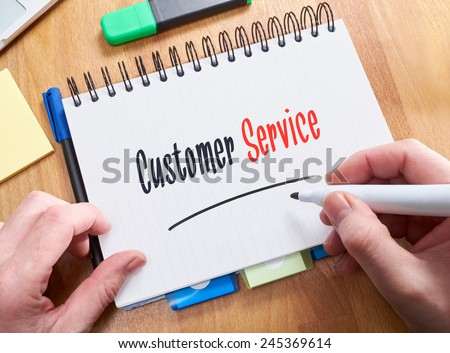 A businessman holding a business card with the words, on a note pad. - stock photo