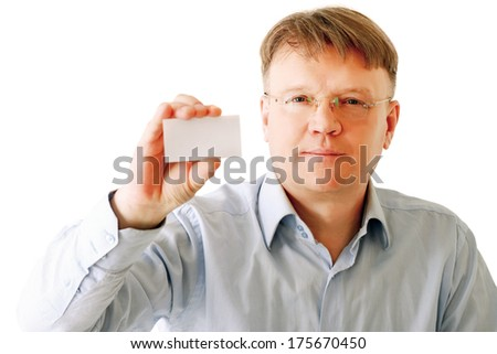 A businessman holding a card - stock photo