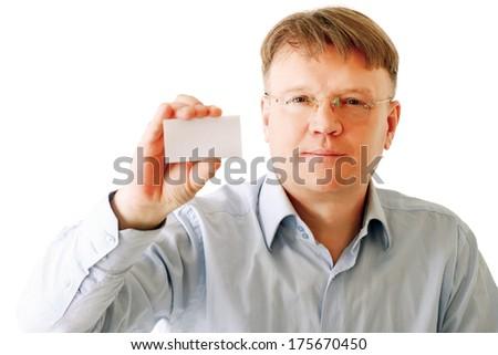 A businessman holding a card - stock photo