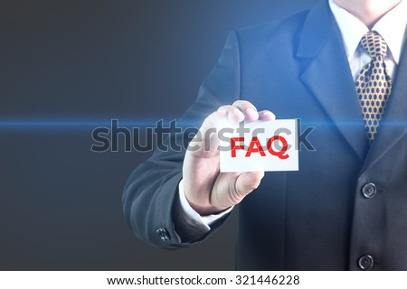 A Businessman holding a white sign with the message faq. Can bring to the medium of your ad. - stock photo
