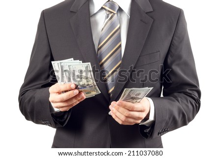 A businessman in a suit counting new hundred dollar bills