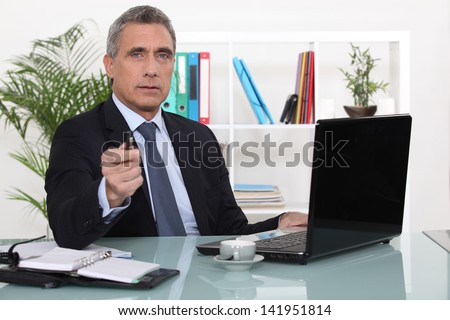 A businessman in his office - stock photo