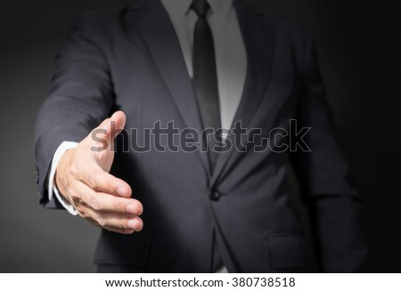 A Businessman in suit  shaking hands