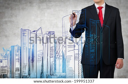 A businessman is drawing a new business center's project plan which is consist of variety of skyscrapers.