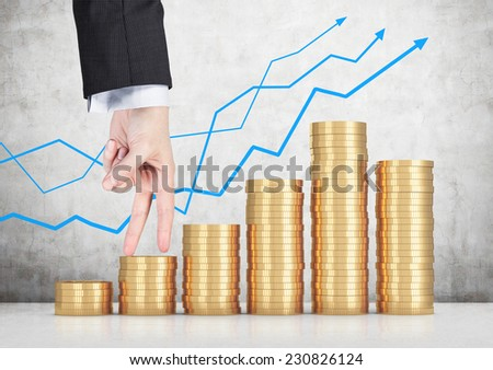 A businessman is going up, coins stair.